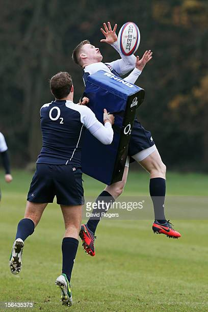 Wing Chris Ashton takes a high ball during the England training session at Pennyhill Park on November 15 2012 in Bagshot England