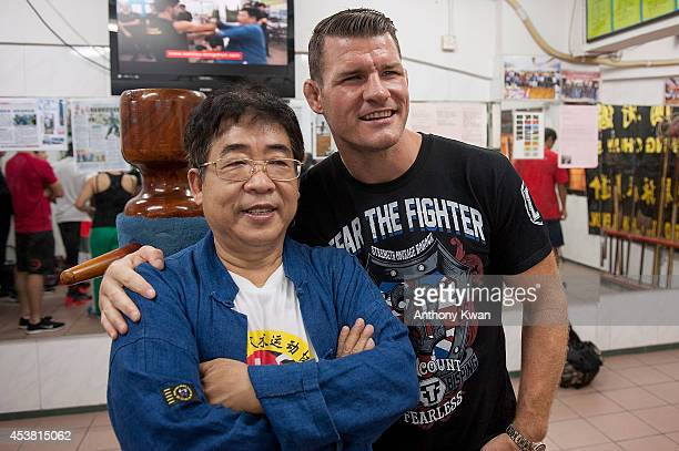 Wing Chun Master Sam Lau and Michael Bisping pose for photos during a UFC workout session at Wing Chun Gym on August 19 2014 in Hong Kong