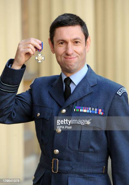 Wing Commander Anthony Millsom poses after he received the New Zealand Bravery Decoration for trying to save two people from a plane that crashed...
