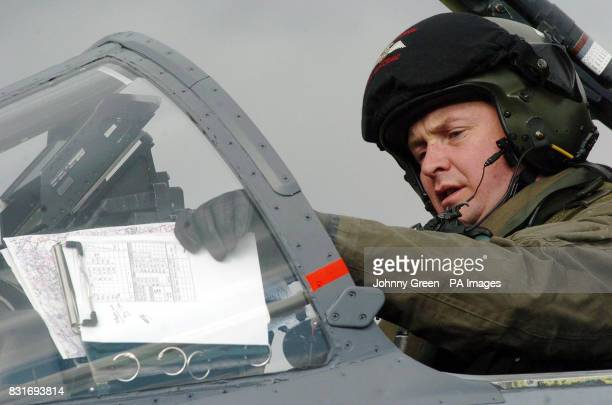 Wing Commander Dick MacCormack prepares for take-off in a SEPECAT Jaguar GR3 aircraft at RAF Coltishall in Norfolk, Saturday April 1, 2006. The...