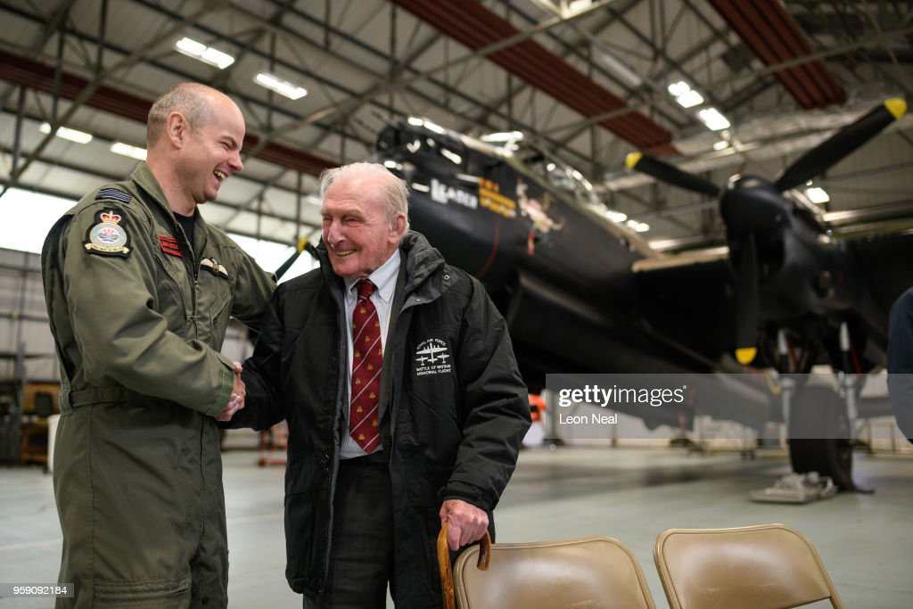Wing Commander John Butcher, Commanding Officer of 617 Squadron, (L) jokes with Britain's last surviving 'Dambuster', Squadron Leader George 'Johnny' Johnson, during an event to mark the 75th anniversary of the 'Dambusters' raids, at RAF Coningsby on May 16, 2018 in Coningsby, England. The Royal Air Force Battle of Britain Memorial Flight was hoping to fly one of the two remaining Avro Lancaster bombers over the Derwent and Ladybower reservoirs, but high winds prevented the aircraft from taking off. 2018 marks the 100th anniversary of the formation of the RAF and the 75th anniversary of the 617 Squadron Dambusters operation. The Dambuster raids, or ''peration Chastise' was an attack on German dams on 16-17 May 1943 by Royal Air Force No. 617 Squadron, using an innovative 'bouncing bomb', which skimmed on the surface of the reservoir before hitting the dam wall and exploding.
