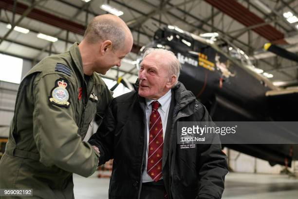Wing Commander John Butcher Commanding Officer of 617 Squadron jokes with Britain's last surviving 'Dambuster' Squadron Leader George 'Johnny'...