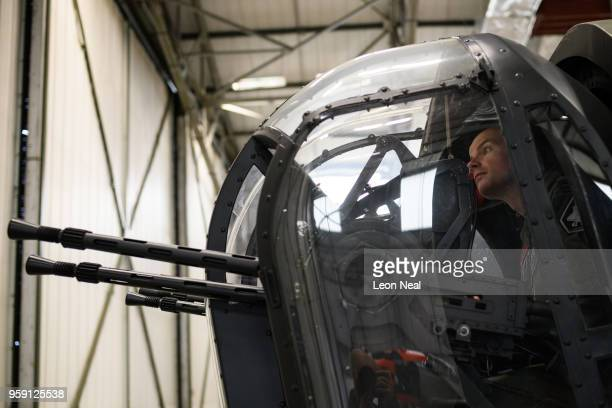 Wing Commander John Butcher Commanding Officer of 617 Squadron sits inside the tailgunner position of one the two surviving airworthy Avro Lancaster...
