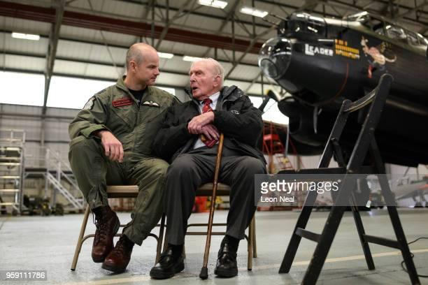 Wing Commander John Butcher Commanding Officer of 617 Squadron speaks with Britain's last surviving 'Dambuster' Squadron Leader George 'Johnny'...