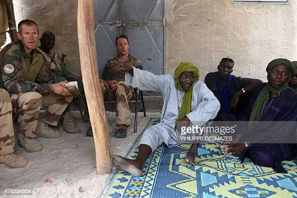 Wing Commander of the 93rd French Mountain Artillery Regiment nicknamed Col 'Zlatan' meets with civilian authorithies of the village of M'Bouna in...