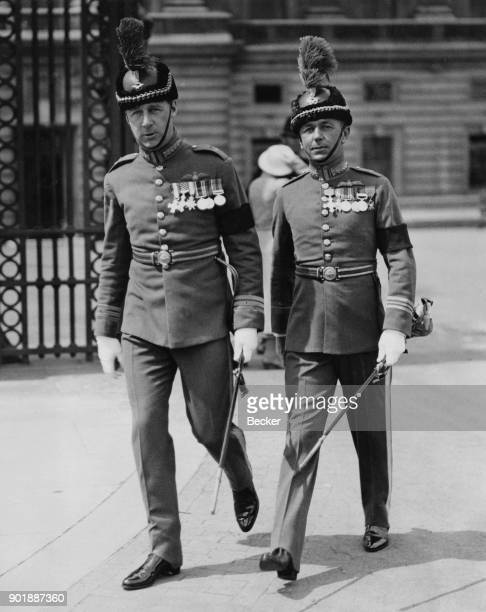 Wing Commander Ralph Sorley and Squadron Leader Cecil Bouchier OBE aka 'Boy' of the RAF leaving Buckingham Palace in London after their investiture...