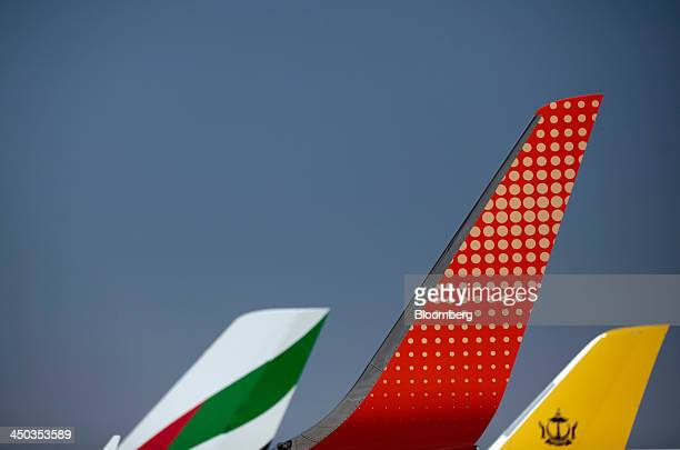 A wing fin on an Fly Dubai aircraft center is seen alongside aircraft the tail fins for Emirates Airline left and Royal Brunei Airlines as the planes...