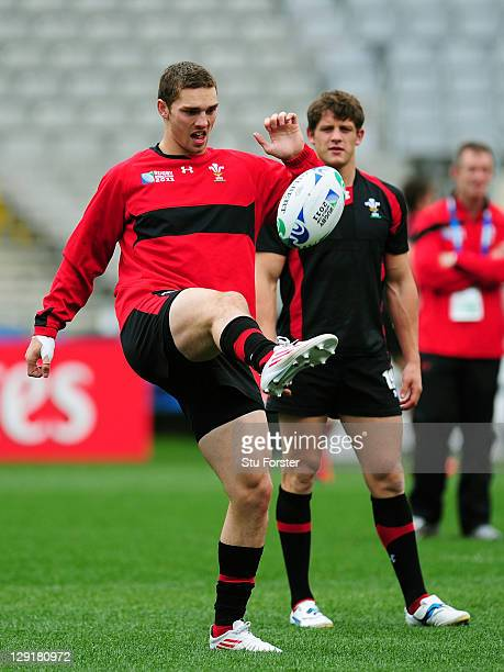 Wing George North juggles the ball as teammate Lloyd Williams looks on during a Wales IRB Rugby World Cup 2011 captain's run at Eden Park on October...