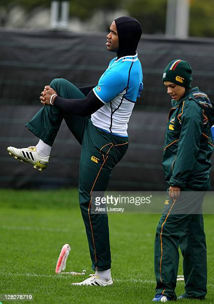 Wing JP Pietersen stretches out under the guidance of Physio Rene Naylor during a South Africa IRB Rugby World Cup 2011 training session at Hutt...