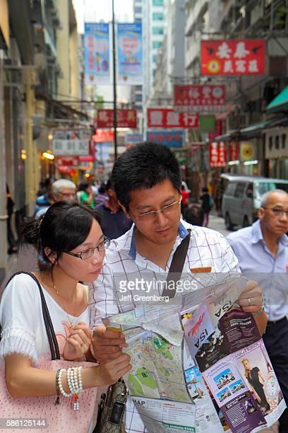Wing Lok Street Asian couple looking at street map