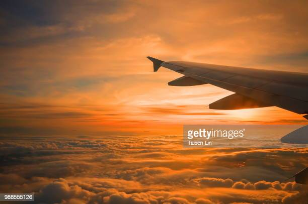 wing of an aeroplane at sunset. - aeroplane stock photos and pictures