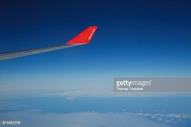 Wing of an airplane of the airline Air Berlin against a blue sky on February 23 2016 in Berlin Germany