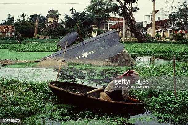 A wing of an American B52 bomber lies where it fell in a residential section of Hanoi when it was shot down during the Christmas bombing of 1972 A...