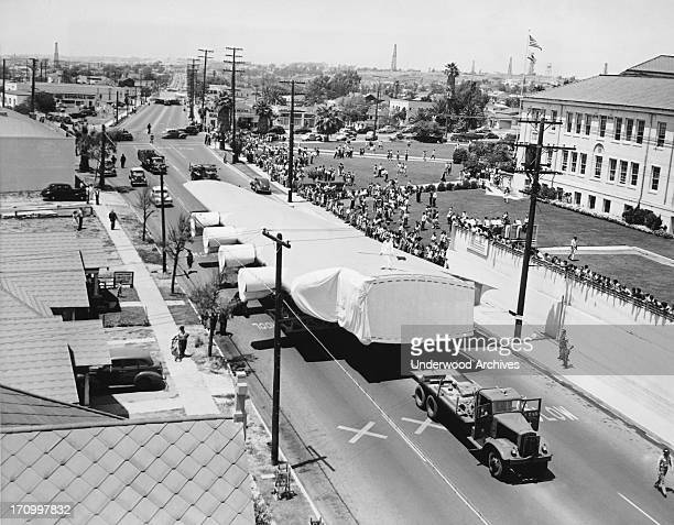 A wing section of Howard Hughes' flying boat the eight engine HK1 passes through Hermosa Beach on its way to the dock at Long Beach where it will be...