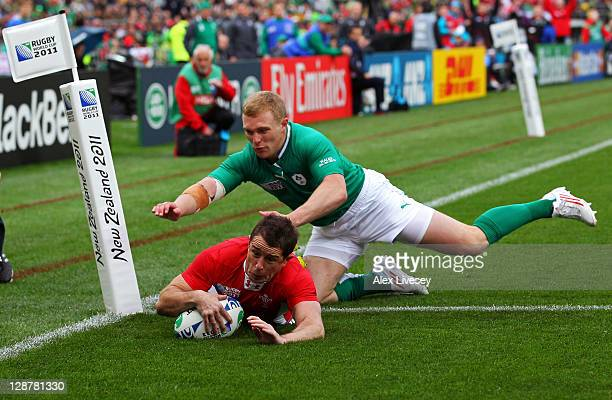 Wing Shane Williams of Wales dives past Keith Earls of Ireland to score the opening try of the match during quarter final one of the 2011 IRB Rugby...
