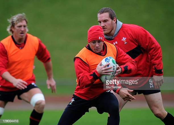 Wing Shane Williams runs through drills with teammates during a Wales IRB Rugby World Cup 2011 media session at Newtown Park on October 5 2011 in...