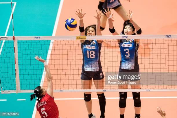 Wing spiker Mami Uchiseto of Japan and Middle blocker Nana Iwasaka of Japan blocks during the FIVB Volleyball World Grand Prix match between Japan vs...