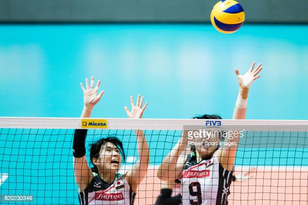 Wing spiker Risa Shinnabe of Japan and Middle blocker Haruyo Shimamura of Japan in action during the FIVB Volleyball World Grand Prix match between...