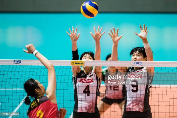 Wing spiker Risa Shinnabe of Japan and Middle blocker Haruyo Shimamura of Japan blocks Wing spiker Ting Zhu of China during the FIVB Volleyball World...