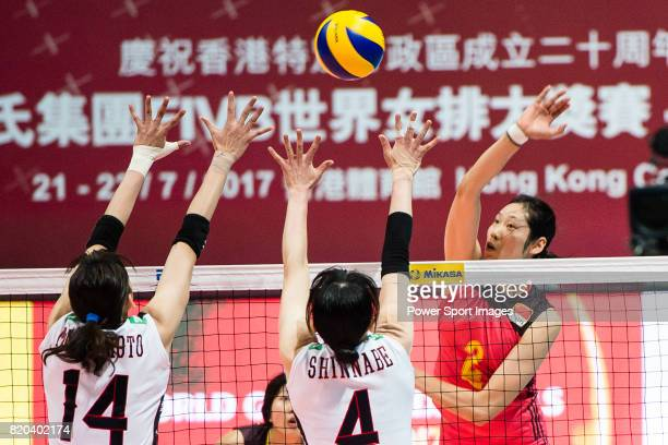 Wing spiker Ting Zhu of China spikes the ball during the FIVB Volleyball World Grand Prix match between China vs Japan on July 21 2017 in Hong Kong...