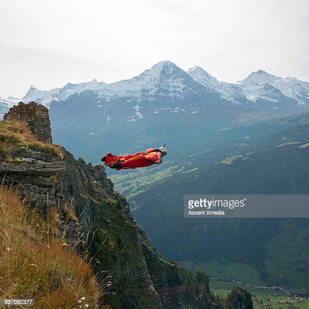 Wing suit flier in flight position after jump