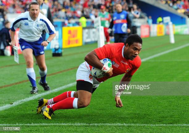 Wing Sukanaivalu Hufanga of Tonga dives over to score the opening try during the IRB 2011 Rugby World Cup Pool A match between France and Tonga at...