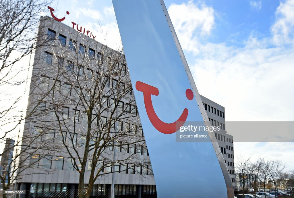 A Wing With The Tui Logo Standing In Front Of Head Office