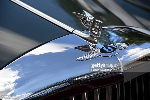 A Winged B Hood Ornament On A Bentley Luxury Automobile Parked In