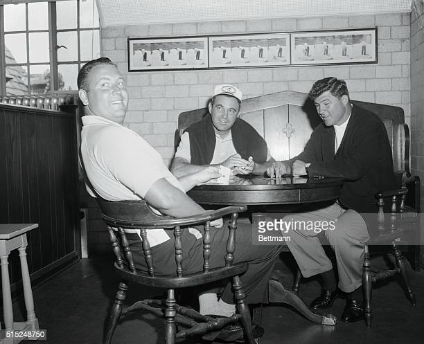 Winged Foot Mamoroneck New York In the club house playing cards during rain are Billy Casper leader 139 shows Ace in the hole card as he plays Stud...
