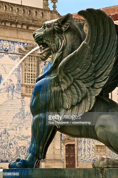 Winged lion fountain in front of azulejos tiles on the Do Carmo church dating from the 18th century, Oporto, Portugal, Europe