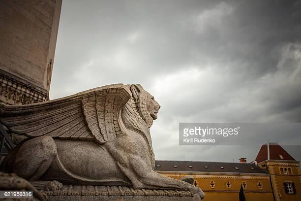 Winged lion statue near the entrance to Basilica of Notre-Dame de Fourvière