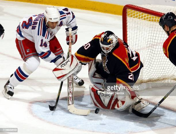 Winger Brendan Shanahan of the New York Rangers shoots against goalie Ed Belfour of the Florida Panthers December 21 2006 at the BankAtlantic Center...
