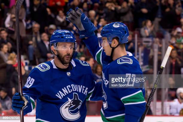 Winger Sam Gagner is congratulated by Vancouver Canucks Right Wing Nikolay Goldobin after scoring a goal against the Chicago Blackhawks during their...