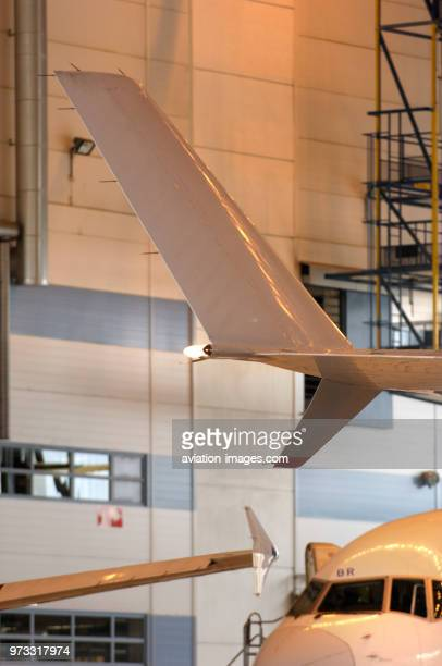 Winglets of a McDonnell Douglas MD-11 and an Airbus A321-200 with windshield of a Boeing 757-200 in hangar Leko 7 at Finnair Technical Services.