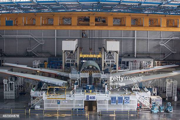 Wings for Airbus A330 passenger jets sit beside a section of aircraft fuselage on the assembly line in the Airbus Group NV factory in Toulouse France...