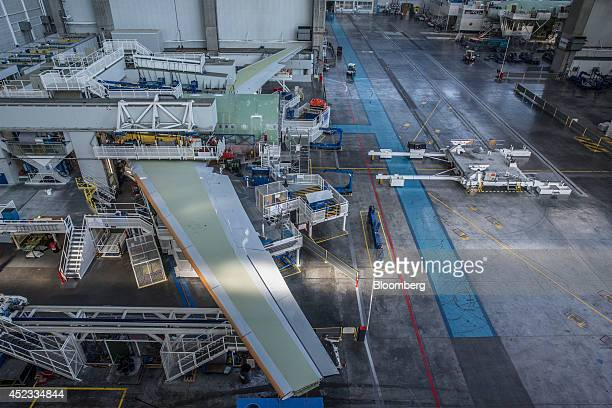 Wings for Airbus A330 passenger jets sit in a hangar before attachment to aircraft fuselage on the assembly line in the Airbus Group NV factory in...