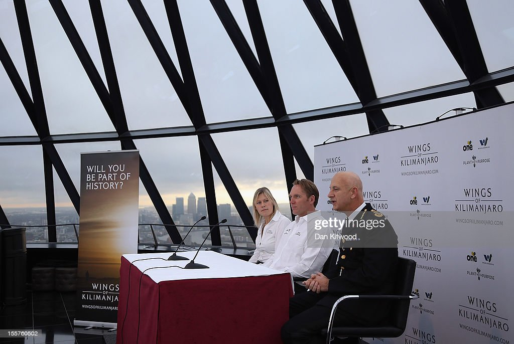 'Wings of Kilimajaro' founder and paragliding pilot Adrian Mcrae (C), Commisioner of Police for the City of London Adrian Leppard (R) and adventurer Squash Falconer, speak to the press during the Launch of the 'Wings Of Kilimanjaro' charity appeal at the top of 30 St Mary Axe, widely known as 'The Gherkin' on November 8, 2012 in London, England. The group will make up a team of around 200 adventurers and 1,000 porters from around the world who plan to climb the summit of Mt Kilimanjaro in Tanzania, before paragliding down from its 5895 metre peak on January 29, 2013. The hope is to raise $1 Million USD for three individual charities; Plant with Purpose, The One Foundation and World Serve International.