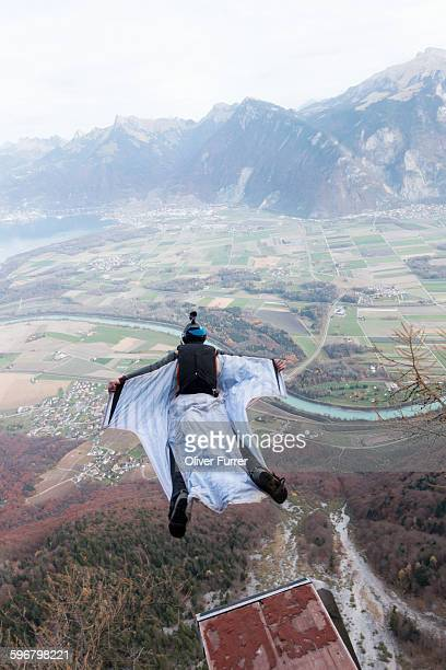 Wingsuit BASE jumper excited from a ramp down.