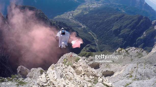 Wingsuit fliers in descent from cliff edge