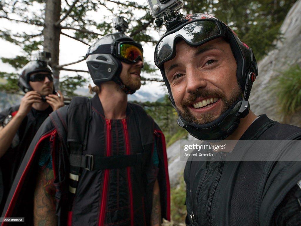 Wingsuit fliers joke together in moment : Stock Photo