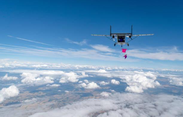 Wingsuit fliers leave airplane rear, in mid-air