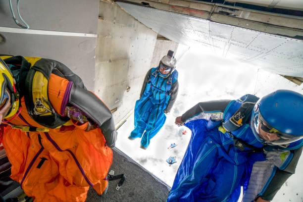 Wingsuit fliers prepare to leave airplane