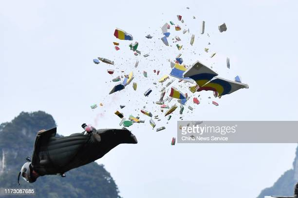 Wingsuit flyer competes during the eighth-final of the 8th World Wingsuit Championship at Tianmen Mountain on September 7, 2019 in Zhangjiajie, Hunan...