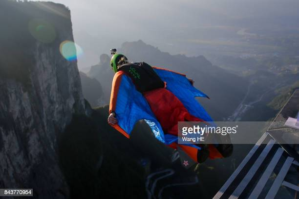 Wingsuit flyer Felix Lorentzen of Norway trial jumps off a mountain during the 6th Carabao World Wingsuit Championship at Tianmen Mountain on...