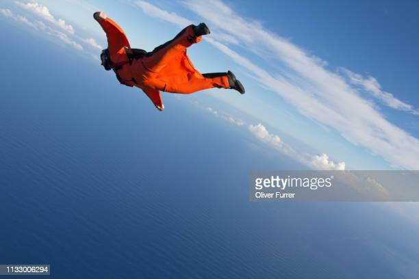 wingsuit flying over north shore of oahu, hawaii - risk stock pictures, royalty-free photos & images