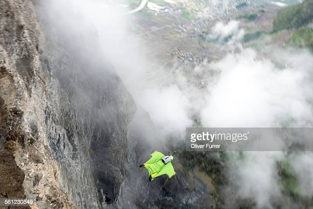 Wingsuit pilot is flying fast down the mountain