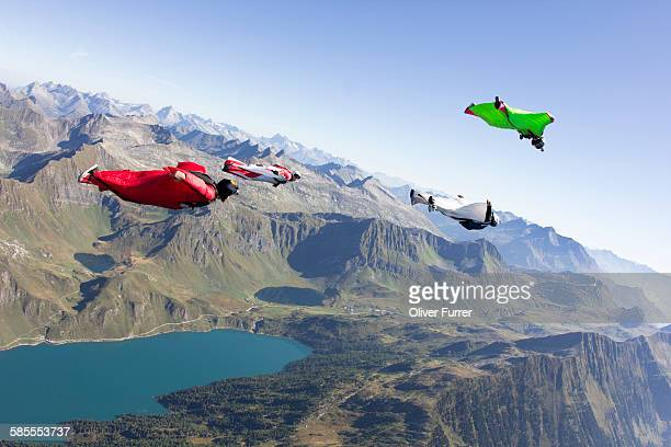 Wingsuit skydivers are flying together in the sky