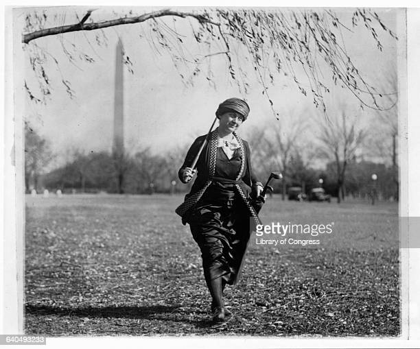 Winifred Mason Huck Carrying Golf Clubs and Bag
