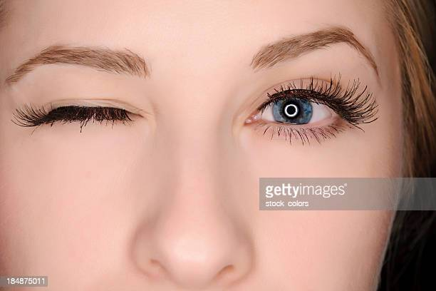 winking eye - false eyelash stock pictures, royalty-free photos & images