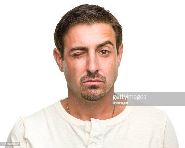 winking man raising one eyebrow - goatee stock pictures, royalty-free photos & images